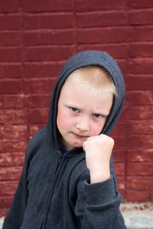 adversary: Children fight near brick wall Stock Photo