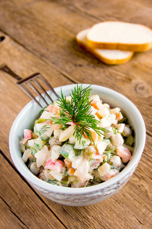 ensalada rusa: Russian salad olivier in bowl over rustic wooden table