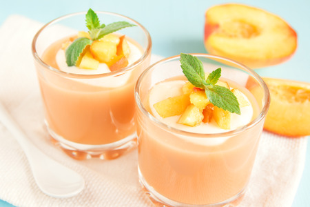 Peach smoothie dessert (mousse) with yogurt and mint in portion glasses