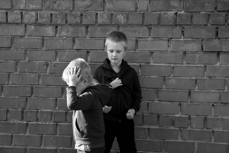 children bullying and fight between two angry aggressive brothers (kids, boys)