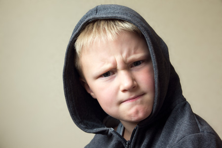 angry kid: Angry child (boy, kid) portrait
