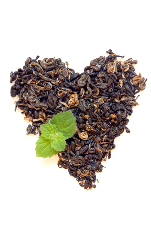 elite: Dry elite black tea heart shape with mint isolated on white background