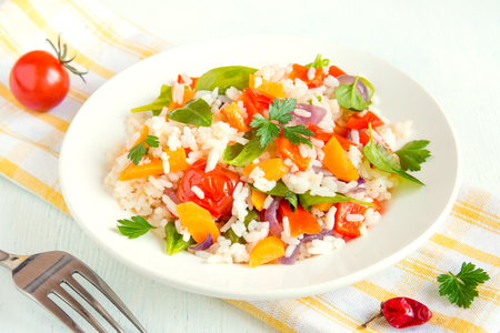 asian food: Vegetarian risotto with white rice and fresh colourful vegetables on plate close up Stock Photo