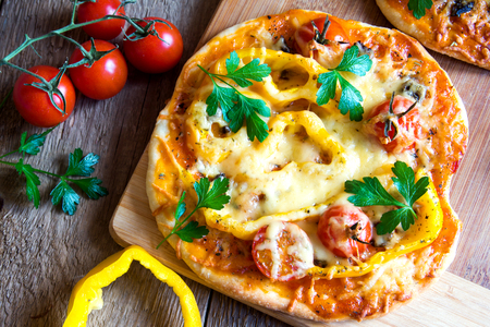 green vegetable: Vegetable pizzas and ingredients on wooden cuting board