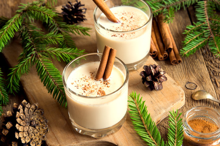 egg white: Eggnog with cinnamon for Cristmas and winter holidays Stock Photo