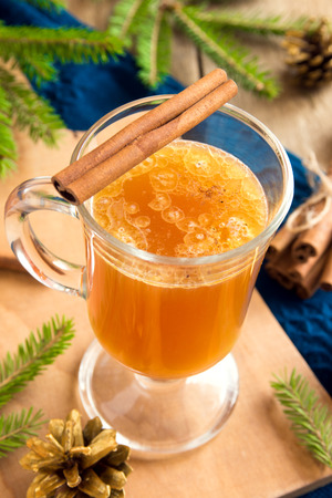 buttered: Hot buttered rum cocktail with cinnamon for Christmas and winter holidays Stock Photo