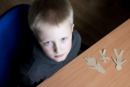 custody: Confused child with broken paper family, family problems, divorce, custody battle, suffer concept