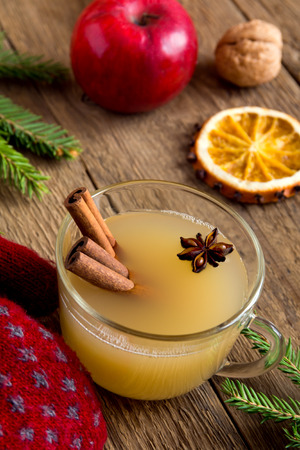 spiced: Apple cider rum punch. Hot drink for Christmas and winter holidays.