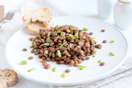 ready to eat: Green lentil on plate, vegetarian dish ready to eat
