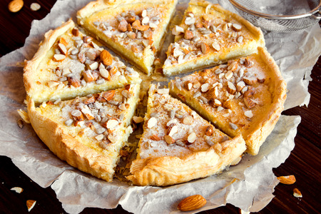 sweet tart: Sweet tart with cottage cheese, caramel, nuts and seeds Stock Photo