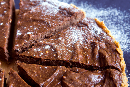 relaxation background: Homemade chocolate pie (cheesecake) with sugar powder close up Stock Photo