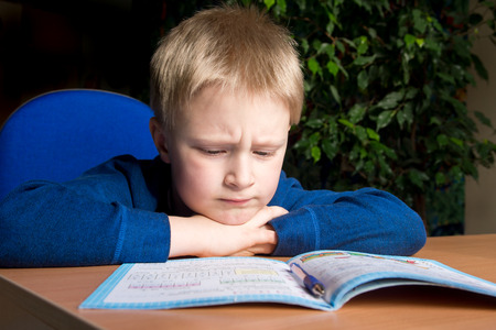 hard core: Tired boring boy dont want to do his difficult school homework Stock Photo