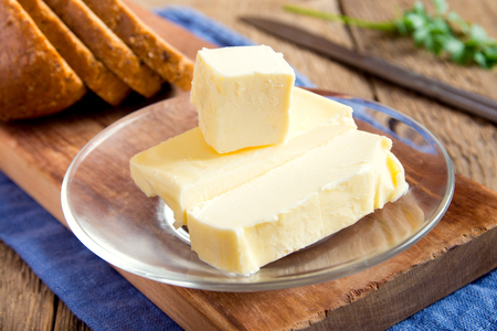 butterfat: Butter over rustic wooden background with copy space Stock Photo