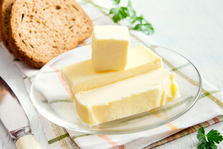 butterfat: Butter over rustic white wooden background