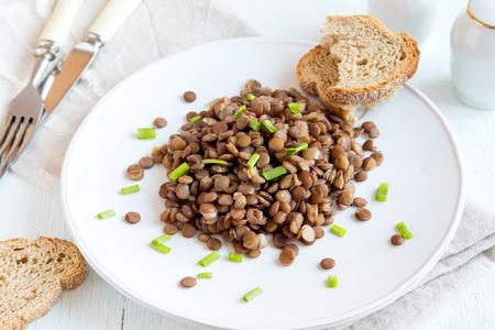 green lentil: Green lentil on plate, vegetarian dish