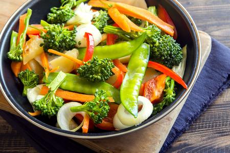 Healthy stir fried vegetables in the pan close up Reklamní fotografie - 61120243