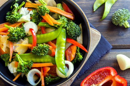 Healthy stir fried vegetables in the pan and ingredients close up Foto de archivo
