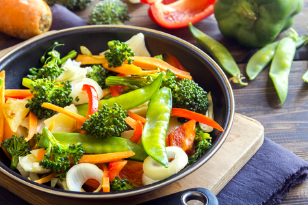 stir up: Healthy stir fried vegetables in the pan and ingredients close up, vegetarian food Stock Photo