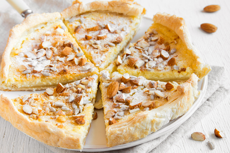 sweet pastry: Homemade pastry - pie with nuts, seeds and mascarpone cheese on white background close up