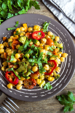garbanzos: Homemade spicy vegetarian stew with chickpeas and vegetables on plate close up - healthy vegetarian food