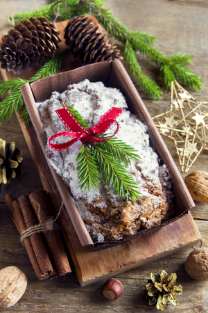 Traditional fruitcake for Christmas with decoration and ornaments - homemade festive Christmas pasrty