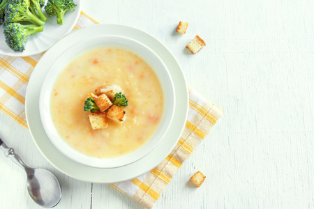 heathy: Vegetable and cheddar cheese cream soup with broccoli and croutons in white bowl, copy space - homemade heathy vegetarian food Stock Photo