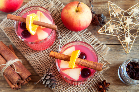 Delicious festive cranberry and apple cider (holiday punch) - homemade Christmas drinks Stock Photo