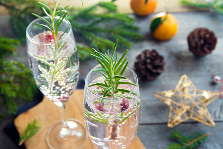 Mimosa festive drink for Christmas - champagne cocktail with rosemary for Christmas party Stock Photo