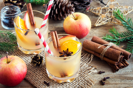 Hot toddy drink (apple orange rum punch) for Christmas and winter holidays - festive Christmas homemade drinks Stock Photo