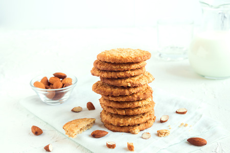 Homemade almond cookies on white table with copy space - healthy homemade vegan vegetarian pastry with almonds nuts Stock Photo