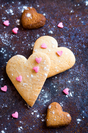 heartshaped: Heart shaped cookies close up for Valentine day - homemade festive pastry buiscuits cookies on rustic metal tray, valentine love concept