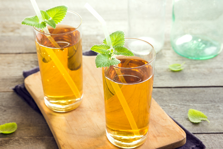 Kombucha tea super food pro biotic beverage in glasses with mint on wooden background - homemade healthy organic fermented probiotic drink Stock Photo