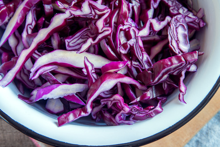 Organic Chopped Red (Blue, Purple) Cabbage in rustic metal bowl - fresh healthy food ingredient, ready for cooking