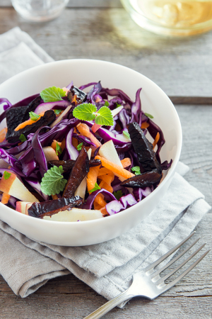 Red Cabbage Coleslaw Salad with Carrots, Apples and Prunes - healthy diet, detox, vegan, vegetarian, vegetable spring salad Stock Photo