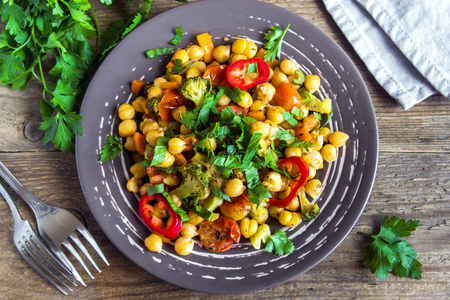 Homemade spicy vegetarian stew with chickpeas and vegetables on plate close up - healthy vegetarian vegan diet protein organic food dish