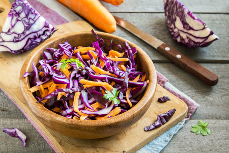 Red Cabbage Coleslaw Salad with Carrots and Greens - healthy diet, detox, vegan, vegetarian, vegetable spring salad, copy space for text Zdjęcie Seryjne