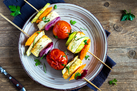 malai: Halloumi cheese and vegetables grilled skewers on plate with spices and herbs close up - healthy vegetarian vegan diet barbecue grilled vegetable homemade meal Stock Photo