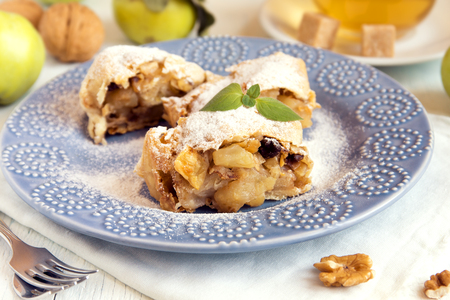 powdered: Homemade apple strudel with apples, raisin and walnuts, vegetarian delicious pastry