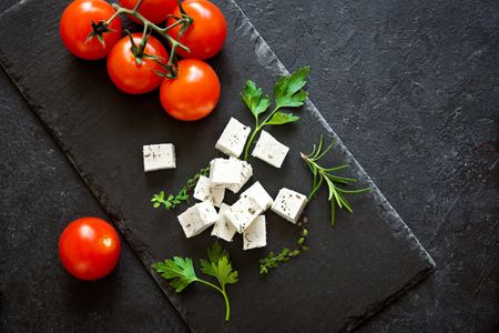 Fresh Greek Feta Cheese. Healthy ingredient for cooking salad. Goat feta cheese with herbs. Stok Fotoğraf