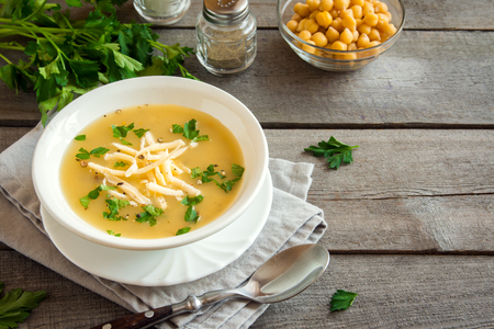 Homemade Chickpea Soup with Cheese and Parsley - healthy organic vegetarian diet vegetable protein lunch meal food soup Stock Photo