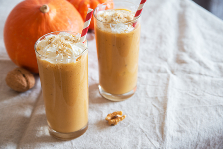 Pumpkin Smoothie. Fresh Pumpkin and Apple Smoothie or Milkshake with Walnuts and Autumn Spices. Seasonal Autumn Drink.