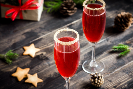 Mimosa festive drink for Christmas - champagne red cocktail Mimosa with cranberry for Christmas party, copy space Stock Photo