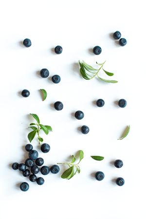 Fresh blueberries with green leaves leaves, organic blueberry pattern isolated on white background, top view. 写真素材
