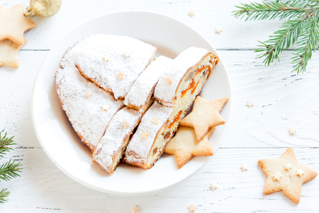Christmas stollen on white background. Traditional Christmas festive pastry, dessert. Stollen and gingerbread cookies for Christmas.