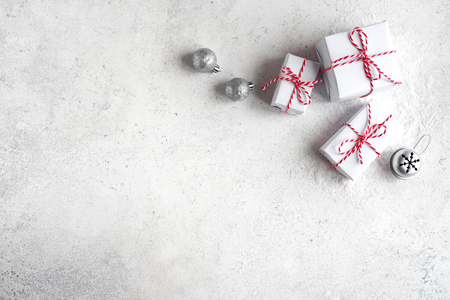Christmas Gift Boxes on white background, copy space. White Christmas Gifts and silver balls, festive composition, concept.
