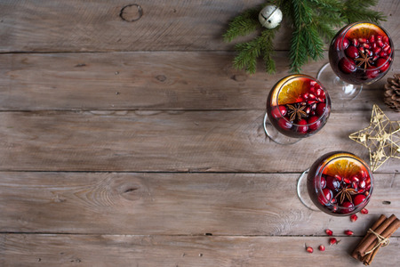 Red Sangria with oranges, pomegranate seeds, cranberry, rosemary and spices - homemade festive drink mulled wine for Christmas time. Stok Fotoğraf