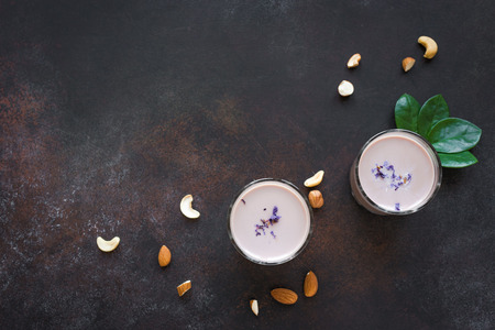 Traditional Indian drink, Holi festival food, Thandai Sardai milk drink with nuts, spices on dark  background, copy space. Banco de Imagens - 119810539