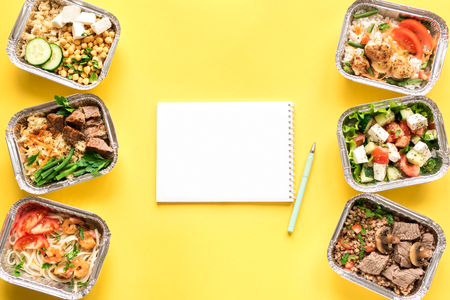 Nutrition meal plan mockup with healthy food delivery. Fitness nutrition for diet. Daily meals in foil boxes, top view, copy space.