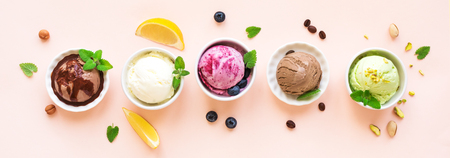 Ice Cream Assortment. Various fruit and berries ice creams on pink background, banner. Frozen yogurt or organic ice cream - healthy summer dessert. Standard-Bild