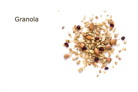 Granola kreatywny układ na białym tle, miejsce. Koncepcja zdrowej przekąski lub śniadanie - domowej roboty granola z ziarnami, suchą żurawiną i orzechami. Zdjęcie Seryjne